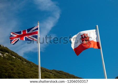 Gibraltar, United Kingdom, 1st October 2018:- The flags of Gibraltar,and United Kingdom flying in Gibraltar. Gibraltar is a British Overseas Territory located on the southern tip of Spain.