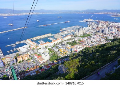 GIBRALTAR, UNITED KINGDOM -28 APR 2019- View of cable car lines for the Gibraltar Cable Car (Teleférico de Gibraltar), an aerial tramway traveling up the Rock of Gibraltar and overlooking the sea.