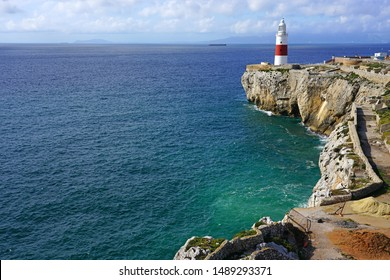 GIBRALTAR, UNITED KINGDOM -29 APR 2019- View of the Europa Point Lighthouse (Trinity Lighthouse at Europa Point, Victoria Tower, or La Farola), a red and white lighthouse in Gibraltar.