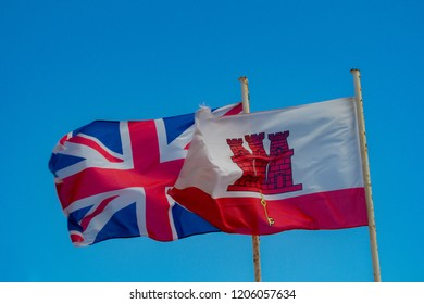 Gibraltar, United Kingdom, 2nd October 2018:- The flags of Gibraltar and the UK flying in Gibraltar.Gibraltar is a British Overseas Territory located on the southern tip of Spain.
