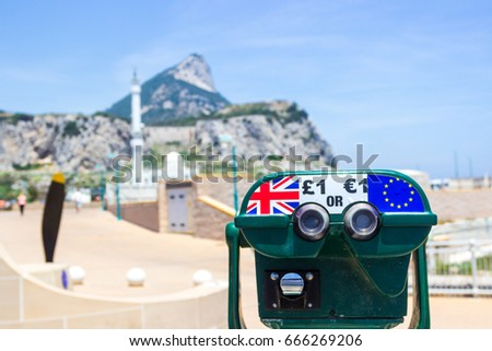 GIBRALTAR, UNITED KINGDOM, BRITAIN, SPAIN - JUNE 10, 2017. A binocular on the Rock of Gibraltar with Pound and Euro symbols represents Brexit: should Gibraltar stay in Great Britain or go to Spain?