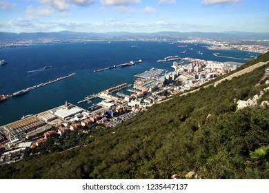 GIBRALTAR, UNITED KINGDOM - OCTOBER 04, 2018. Port, city and Algeciras Bay around of the Rock of Gibraltar in United Kingdom.