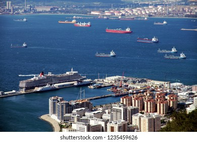 GIBRALTAR, UNITED KINGDOM - OCTOBER 04, 2018. Lots of tankers and containers ships anchored joint to the Port and city of the Rock of Gibraltar in United Kingdom.