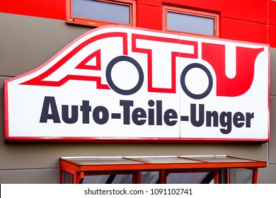 GIESSEN, GERMANY - 25 MARCH: The company sign of the garage and tire changer ATU, Auto Parts Unger, on the facade of a building on March 25, 2018 in Giessen - Auto Parts Unger