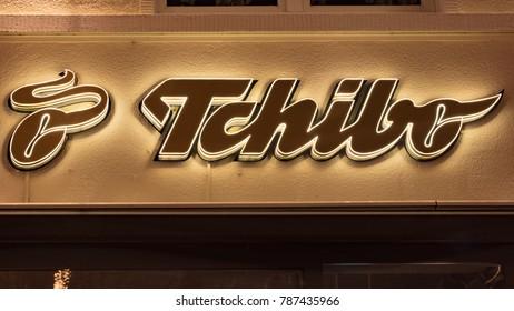 GIESSEN  GERMANY DECEMBER 2017: Illuminated  Logotype of TCHIBO.  TCHIBO is a coffee roasting chain based in Hamburg.