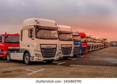 Giessen, Netherlands - July 05, 2019: DAF trucks staying on the logistic company parking.