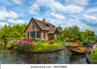 GIETHOORN - JULY 28: view of Giethoorn village on July 28, 2017 in Giethoorn, The Netherlands. Giethoorn is also called 'Venice of The Netherlands' and receives around 800.000 visitors yearly.