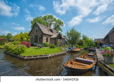 GIETHOORN, NETHERLANDS - JULY 3: view of typical houses of Giethoorn on July 3, 2013 in Giethoorn,The Netherlands. Giethoorn is also called 'the Venice of Holland' and receives 15.000 visitors yearly.