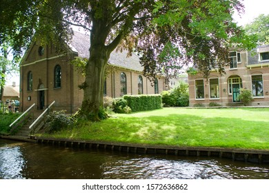 Giethoorn, The Netherlands - june 15 2017: The rectory next to the church along the water in Giethoorn