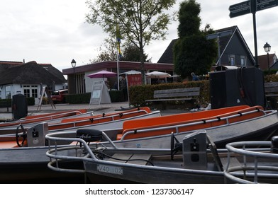 Giethoorn, Netherlands - September 28 2018: Chinese tourists takes a sail on the boat through the canals