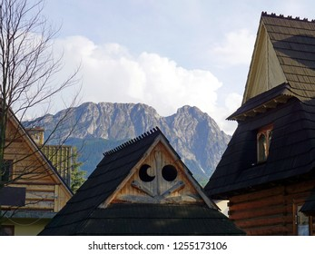 Giewont Mountain over traditional wooden rooftops. Zakopane, Poland