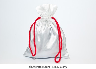 gift bag with red ribbon