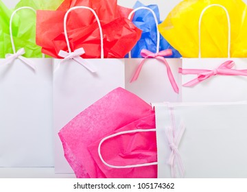 gift bags adorned nicely to represent many things. Hand made with ribbon and tissue paper.