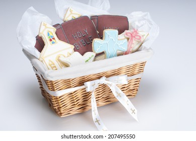 Gift basket of Christian cookie shapes: cross, dove, bible, and church. Shot with copy space.