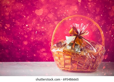 gift basket with festive heart particles, purple background