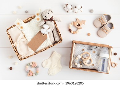 Gift basket with gender neutral baby garment and accessories. Care box of organic newborn cotton clothes