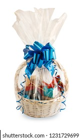 gift basket packed in transparent paper with a big blue bow isolated on a white background