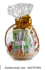 gift basket packed in transparent paper with a big yellow bow isolated on a white background
