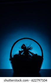 gift basket silhouette on blue background
