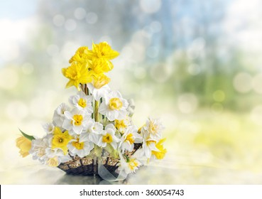 A gift basket with spring flowers on bokeh background with space for your text. vintage style