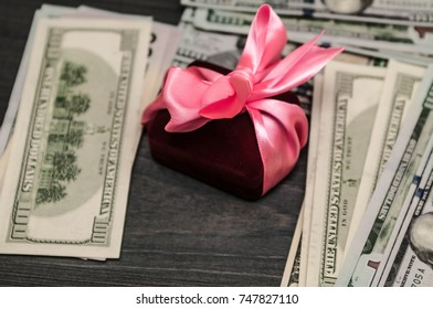 Gift between cash. offer of hand and heart.