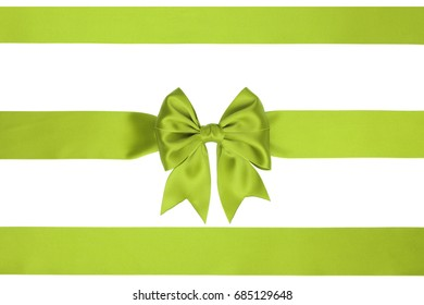 Gift bow on ribbon decoration with two horizontal lime ribbon, on white background