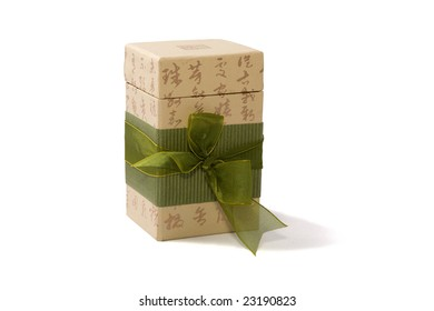 Gift box in asian style with hieroglyphs and green ribbon. Isolated on white. Path included.