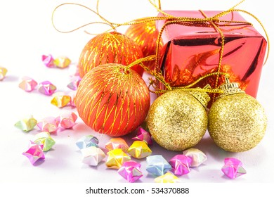 Gift box and Christmas accessory on white background