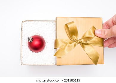 Gift box with a christmas ball inside