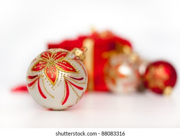 Gift box and christmas balls on white background