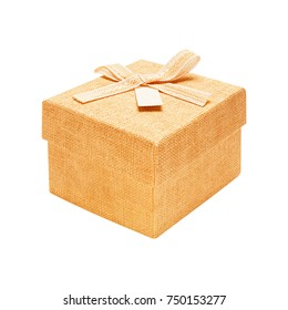 Gift box close fabric texture beige with a bow isolated