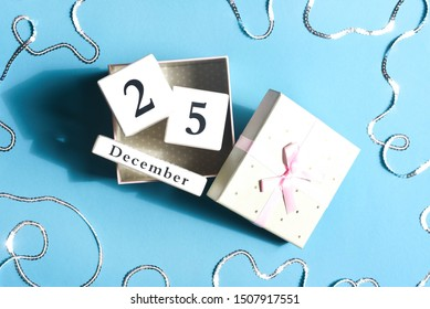 Gift box with cubes with a date of Christmas.