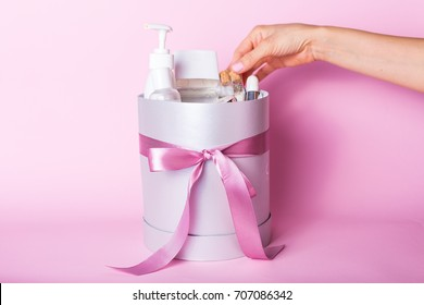 Gift box decorated with ribbon filled with cosmetics