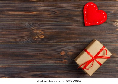Gift box with fabric hearts on Black wooden table.