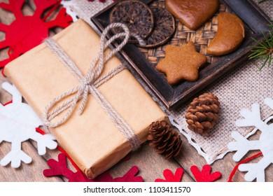 Gift box, gingerbread cookies, fir tree branch, handmade snowflake