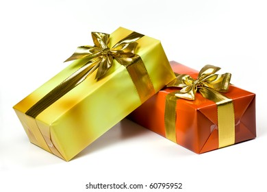 Gift box and golden ribbon, isolated on the white background