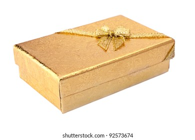 Gift box with golden surface and shiny ribbon. Isolated white background. Clipping path included.
