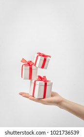 Gift box in hand against white background
