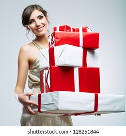 Gift box in the hands of young woman. Happy woman  isolated. Evening dress of gold color.