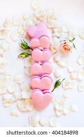 Gift box of heart shaped macaron. Selective focus. Natural light