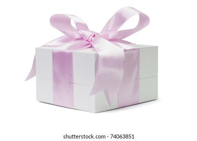 Gift box with large pink bow ribbon on white background
