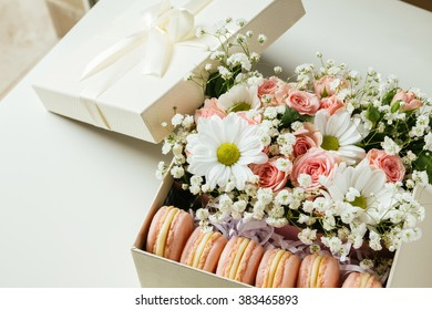 Gift Box With Macaroons And Flowers