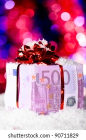 gift box made of euro on blurred background