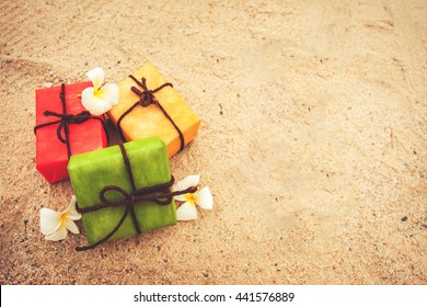 gift box from nature and flower on sand beach  background, vintage color tone. decoration for Christmas and Happy new year holiday.
