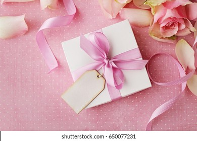 gift box with note, rose flowers