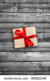Gift box on black and white wooden background