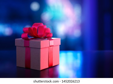 Gift box on blurred bokeh light background with copy space