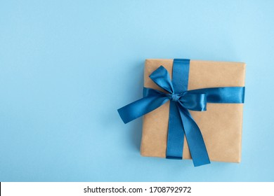 Gift box on light blue background. Fathers day, birthday and holiday concept. Top view, flat lay, copy space