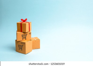 A gift box on a pile of boxes. The concept of finding the perfect gift. Limited offer Buy a gift on time. Sale, big discounts and excitement before the holidays. Search and achieve the goal