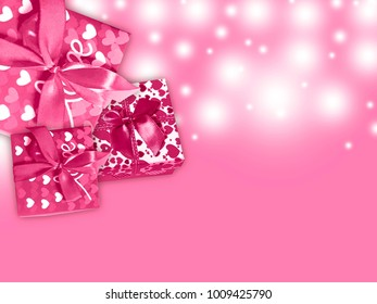 Gift box on a pink background.